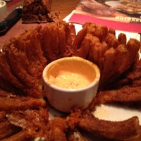 Photo taken at Outback Steakhouse by Lori M. on 6/4/2012