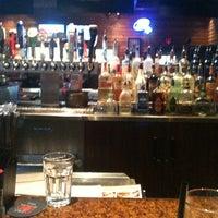 Photo taken at Smokey Bones Bar & Fire Grill by Lulu P. on 6/7/2011