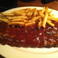 Photo taken at Outback Steakhouse by Leandro H. on 3/5/2012