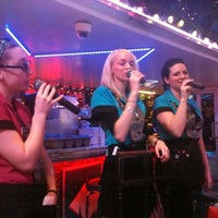 Photo taken at Ellen's Stardust Diner by Humberto A. on 1/2/2012