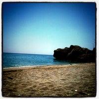 Photo taken at El Salón Beach by David S. on 5/23/2011