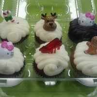 Photo taken at Mad Hatter Cupcakes by GlamSquad S. on 12/3/2011