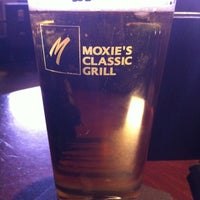 Photo taken at Moxie's Classic Grill by Rene M. on 3/4/2011