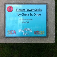 Photo taken at Flower Power Sticks Sculpture by Amy F. on 5/7/2011