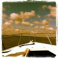 Photo taken at on a boat by Candice M. on 7/28/2012