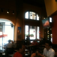 Photo taken at Specialty's Café & Bakery by Stacy M. on 8/14/2012