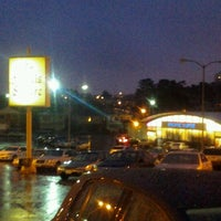 Photo taken at St Francis Square Shopping Center by Salvador D. on 4/26/2012