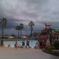 Photo taken at Moody Gardens Wave Pool by Deven N. on 8/5/2012