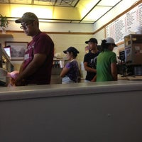 Photo taken at Hole In One Donuts by Karen B. on 4/27/2012