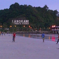 Photo taken at Pantai Cenang (Beach) by Karma K. on 9/29/2011