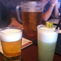 Photo taken at Boston Pizza by Kelly M. on 8/10/2012