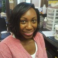 Photo taken at Shear Perfection Hair Salon & Barber/Braiding Shop by Lil-Bit on 12/31/2011