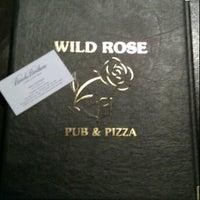 Photo taken at Wild Rose Pub by Glenn B. on 12/22/2011