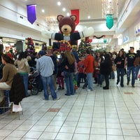 Photo taken at Grand Central Mall by Flora L. on 12/17/2011