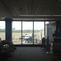 Photo taken at Gate C23 by Thomas C. on 9/3/2012
