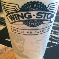 Photo taken at Wingstop by J . on 7/4/2012