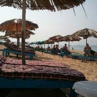 Photo taken at Candolim Beach by Anita K. on 11/15/2011