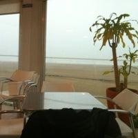 Photo taken at Praia do Titan by Andre F. on 10/23/2011