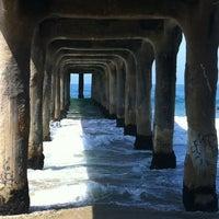 Photo taken at Manhattan Beach Pier by John J. on 8/11/2012