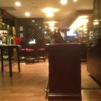 Photo taken at Quinn's Steakhouse & Bar by MJ V. on 12/11/2011