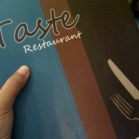 Photo taken at Taste Restaurant by linda a. on 10/26/2011