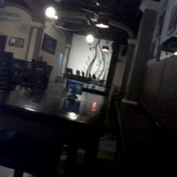 Photo taken at El Raco Restaurant Bar by Laura H. on 11/17/2011