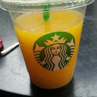 Photo taken at Starbucks by margaux t. on 1/26/2012