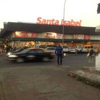 Photo taken at Santa Isabel by Cristhian V. on 3/22/2012