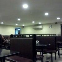 Photo taken at 50 Bucks Multi Cuisine Restaurant by Poovannan R. on 9/5/2011