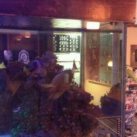 Photo taken at Blue Lotus Tattoo by Chris K. on 12/13/2011