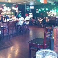 Photo taken at McGrady's Irish Pub by Casey B. on 7/19/2011