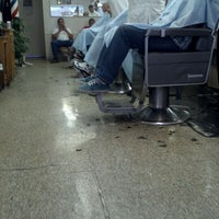 Photo taken at Del's Barber Shop by Tim C. on 5/9/2012