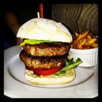 Photo taken at Ring Café & Burger Bar by Radim S. on 5/16/2012