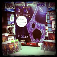Photo taken at GameStop by Tierra M. on 3/20/2012