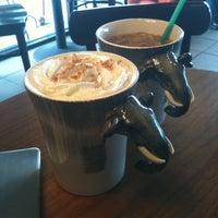 Photo taken at Starbucks by Gaby T. on 12/27/2011