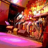 Photo taken at Raglan Road Irish Pub by Stefanie B. on 7/14/2012