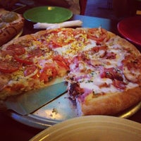 Photo taken at Buenos Aires Pizzeria by Yuki O. on 6/27/2012