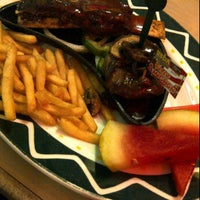 Photo taken at Sizzler American Grill - Plaza Semanggi by Amin S. on 10/10/2011