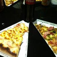 Photo taken at Mulino Pizzeria by Aline B. on 11/10/2011
