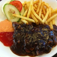 Photo taken at Restoran Lotus (Restaurant) by Elly A. on 7/25/2011