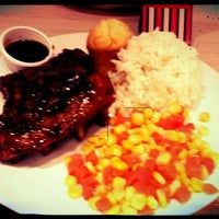 Photo taken at Kenny Rogers Roasters by Ciamille S. on 1/11/2012