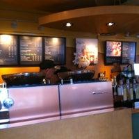 Photo taken at Starbucks by July V. on 5/24/2011