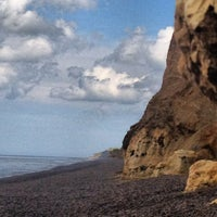 Photo taken at Weybourne Beach by Laura F. on 7/7/2012