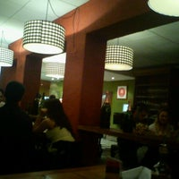 Photo taken at Vinícius Pizzaria by Jocasta L. on 3/11/2012