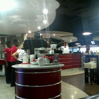 Photo taken at Manchester United Red Café by Ha K. on 9/11/2011