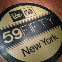 Photo taken at New Era Flagship Store: New York by Dre on 9/8/2012