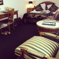 Photo taken at Ambassade Hotel by Elena C. on 7/13/2012