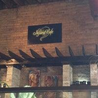Photo taken at Iguana Café by Amy C. on 8/26/2012