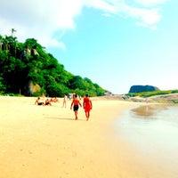 Photo taken at Praia dos Paraguaios by Homero M. on 1/7/2012