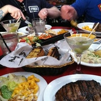Photo taken at Gaslamp Strip Club Restaurant by Evan C. on 7/28/2011